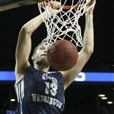 George Washington's Patricio Garino dunks against Rhode Island in the quarterfinals of the Atlantic 10 tournament Friday in New York. Garino is the Colonials leading scorer at 12.4 points per game.