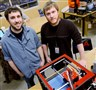 BoXZY, which houses a 3-D printer, a computer-controlled router and a laser, was created by Justin Johnson, left, and his brother Joel at TechShop in Bakery Square.