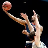 Robert Morris' Rodney Pryor lays the ball up against North Florida's Beau Beech in the first half of the First Four game of the NCAA tournament in Dayton, OH, on March 18, 2015.