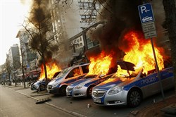 Four German police cars were set on fire Wednesday by anti-capitalist protesters burn near the European Central Bank building hours before the official opening of its new headquarters in Frankfurt.
