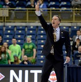 Pitt head coach Jamie Dixon calls out a play during his team's NIT loss to George Washington on Tuesday.