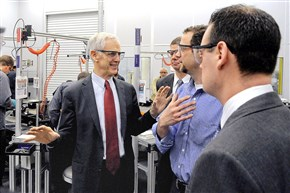 From left: Commerce Secretary John Bryson talks with Aquion Energy CEO Scott Pearson and CTO Jay Whitacre along with then-Pittsburgh Mayor Luke Ravenstahl during a tour of the company in 2012.