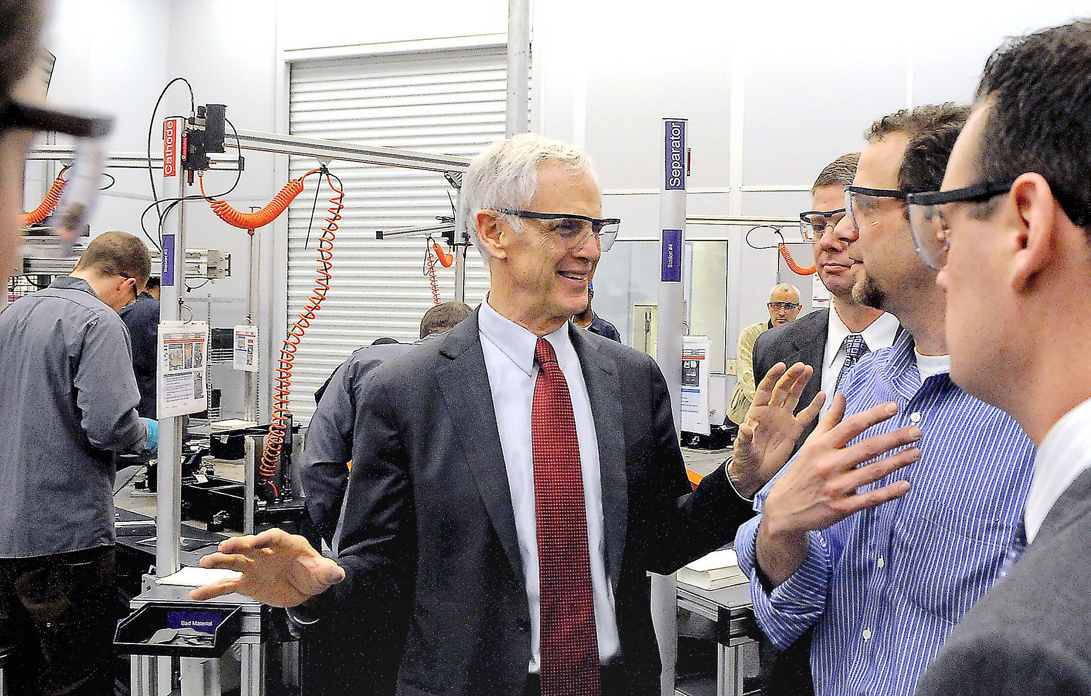 92800kmk-1 From left: Commerce Secretary John Bryson talks with Aquion Energy CEO Scott Pearson and CTO Jay Whitacre along with then-Pittsburgh Mayor Luke Ravenstahl during a tour of the company in 2012.