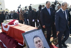 Tunisian Interior Minister Mohamed Najem Gharsalli, second from right, and House Speaker Mohamed Ennaceur, right, attend the funerals of elite security member Aymen Morjen Thursday. Mr. Morjen was killed in the Wednesday attack at the Bardo National museum.