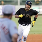 Tony Sanchez rounds third base after hitting a two-run home run during the second inning of Wednesday's game in Bradenton, Fla.