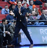 Robert Morris head coach Andy Toole applauds his team as they take on North Florida in the second half of the First Four game of the NCAA tournament in Dayton, OH.
