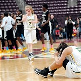 Seton-LaSalle's Nicolete Newman and her teammates react after losing to Neumann-Goretti, 79-34, in the PIAA Class AA championship last Friday at Giant Center in Hershey, Pa.