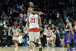 N.C. State's Anthony Barber celebrates with BeeJay Anya after defeating LSU in the second round of the NCAA tournament at Consol Energy Center.