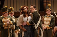 From final dress rehearsal of Carmen at Pittsburgh Opera. Micaela (Jasmine Muhammad) comes to Seville looking for her fiance Don Jose, but must fend off a group of admiring soldiers, including an overly friendly Morales (Alex DeSocio).
