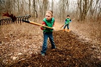 Bruce Goodman and Matthew Burns, both 7, spread mulch on a trail at the Pittsburgh Botanic Garden in Oakdale as part of a service project for their Cub Scout Pack 225.