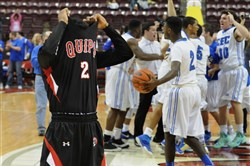 Aliquippa's Stephon McGinnis walks off the court after his team lost to Conwell-Egan 51-62 in the PIAA Class AA Championship Game at Giant Center in Hershey on Saturday.
