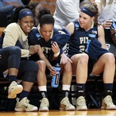 Pittsburgh players Brittany Gordon, left, Brianna Kiesel, center, and Monica Wignot celebrate in the final seconds of the second half.