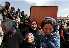 Afghan women's rights activists carry the coffin of Farkhunda, 28, an Afghan woman who was beaten to death and set on fire Thursday, during her burial ceremony Sunday in Kabul.