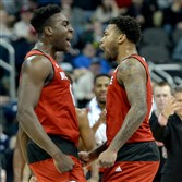 North Carolina State's Abdul-Malik Abu celebrates a dunk with Trevor Lacey against Villanova in the first half of the third round of the NCAA tournament Saturday at Consol Energy Center.