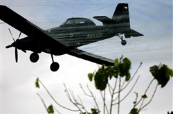 FILE - In this Dec. 15, 2006, file photo, a plane sprays coca fields in San Miguel, on Colombia's southern border with Ecuador. The new labeling on Thursday, March 19, 2015, of the world's most-popular weed killer as a likely cause of cancer could jeopardize the future of an aerial spraying program in Colombia that is the cornerstone of the U.S.-backed war on drugs. (AP Photo/William Fernando Martinez,File)