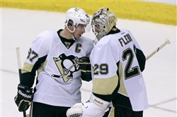 Marc-Andre Fleury is congratulated by Sidney Crosby after a 3-1 Penguins victory against the Arizona Coyotes Saturday in Glendale, Ariz.