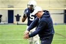 Defensive coordinator Bob Shoop instructs during spring practice drills inside Holuba Hall.