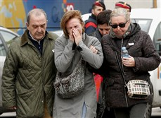 Family members of passengers that were aboard a passenger jet that crashed in the French Alps react Tuesday at Barcelona's El Prat airport. All 150 aboard the flight, an Airbus operated by a subsidiary of German-owned Lufthansa, are feared dead after the plan plummeted into a remote region of southern France.