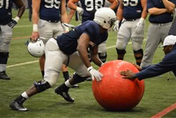 Defensive end Curtis Cothran works through drills at a past Penn State practice.