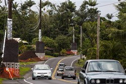 Reinforced utility poles line Pahoa Valley road in Pahoa, on the big island of Hawaii. Residents of Pahoa have learned to adapt as a slow-moving lava flow menaces their community.