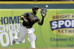 Pirates center fielder Andrew McCutchen catches a fly ball hit by Orioles designated hitter Delmon Young on Tuesday in Bradenton, Fla.