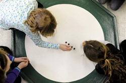 Skylar Buchman, left, sets up marbles with Jocelyn Geiger last year at the Boys and Girls Club in Millvale. They were practicing for the Allegheny County Marbles competition.