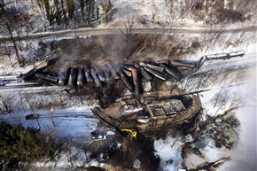 Response crews for the train derailment near Mount Carbon, W. Va., monitor the burning cars in February next to the Kanawha River.
