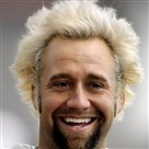 With his blond hair in full force, Steelers kicker Jeff Reed flashes a smile before practice in January 2009.