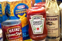 Kraft and Heinz products are shown in Chicago, Ill. Kraft Foods Group Inc. said it will merge with H.J. Heinz Co. to form the third largest food and beverage company in North America with revenue of about $28 billion.