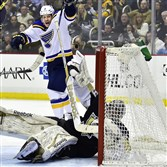 The Blues' Zbynek Michalek celebrates a second period goal by Marcel Goc to tie the game as Penguins goalie Marc-Andre Fleury falls into the net last night at the Consol Energy Center.