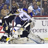 St. Louis' Paul Stastny falls into Marc-Andre Fleury in the first period Tuesday and is called for goaltender interference. The Penguins lost to the Blues, 3-2, in overtime at Consol Energy Center.