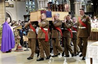 "The coffin of England's King Richard III is carried Thursday by pallbearers during a reinterment service for his remains at Leicester Cathedral in Leicester, England. The remains of Richard III, the last English king killed in battle, were found three years ago under a parking lot. Queen Elizabeth II called the reinterment of ""great international significance."" Richard III died in 1485."