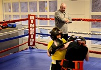 Jessee Mook, 11, left, spars with Sami Spinks, 28, as Mook's father and boxing coach Jack Mook guides them at an old city firehouse that has been converted into a boxing gym for Steel City Boxing on Homer Street in Spring Hill on Thursday, March 26, 2015.