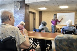 Tina Reese leads a word game for residents at a nursing home in Lancaster, Pa., in 2013. Life insurance firms pitched long-term care policies as the prudent way for Americans to shoulder the cost of staying in nursing homes. But those same companies have found that long-term-care policies are squeezing their profits.
