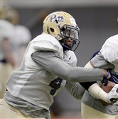 Pitt's Bam Bradley works through drills during spring practice last month at the team's facility on the South Side.