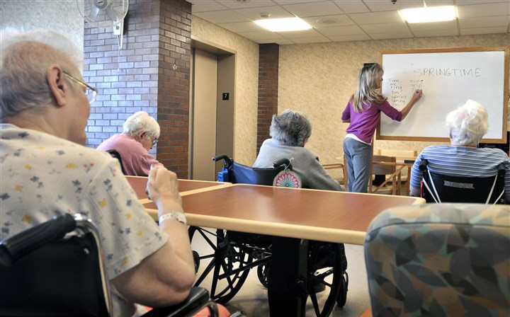 eldercare Tina Reese leads a word game for residents at a nursing home in Lancaster, Pa. Long-term care insurance policyholders who spent many years unaccustomed to rate increases have been undergoing price shock recently, a quietly disturbing trend that will be spelled out publicly in Pennsylvania for the first time this week.