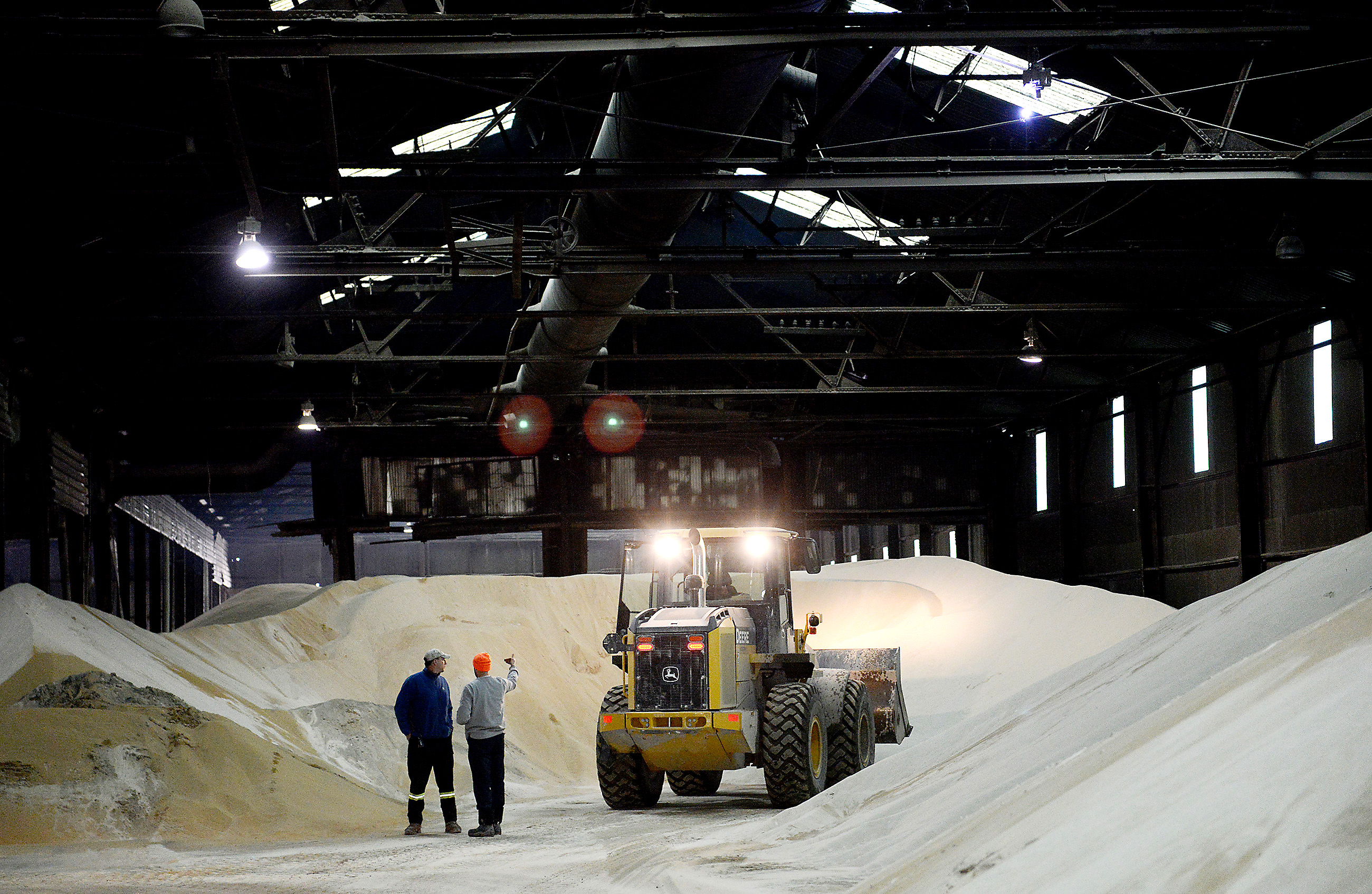 20150320MWHmrieBiz10-9 Michael Henninger/Post-Gazette 20150320 mrie Biz 03/20/2015 Employees survey and move frack sand stored in warehouse facilities at McKees Rocks Industrial Enterprises (MRIE). Two more 30,000-square-foot buildings are slated to open this year to store frack sand, according to Jim Lind, an owner at MRIE.