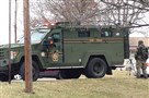 A SWAT team surrounds an apartment in Hempfield today.