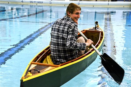 Elizabeth Forward senior Tyler Wachs built a canoe in the school's new FABLab, which allowed him to design the canoe on a computer that then cut the pieces for him. Here, he gives the canoe its second voyage in the high school pool.