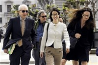 Ellen Pao, center, walks to the Civic Center Courthouse in San Francisco on Friday.