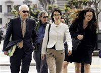 Ellen Pao, center, walks to Civic Center Courthouse in San Francisco on Friday.