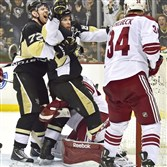 Sidney Crosby is helped to his feet after scoring the game winner in the third period Saturday against the Coyotes at the Consol Energy Center.