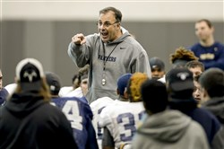 New Pitt coach Pat Narduzzi talks to his team Saturday morning. The Panthers are two weeks into spring practice. They have three more weeks before the Blue-Gold game April 18.