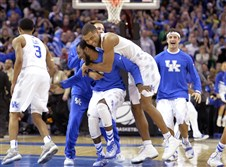 Kentucky players celebrate after a 68-66 win over Notre Dame in an Elite Eight game Saturday night in Cleveland.