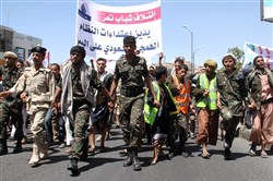 Yemeni Shiite Houthi rebels and supporters take part in a demonstration in the southwestern city of Taez against the Saudi-led military intervention in the country on March 29.