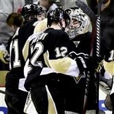 Marc-Andre Fleury is congratulated after helping the Penguins pull out a shootout victory Sunday night.