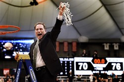 Michigan State coach Tom Izzo holds up the net after his team defeated Louisville 76-70 in overtime in the NCAA men's college basketball tournament East Regional in Syracuse, N.Y., Sunday, March 29, 2015.