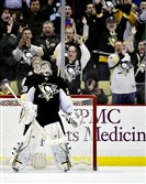 Marc-Andre Fleury breathes a sigh of relief after making a save on the Sharks Logan Couture in the shootout for the win at the last night at the Consol Energy Center.