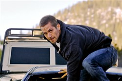 "Brian, portrayed by the late Paul Walker, makes a move in ""Furious 7."""