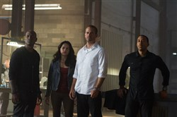 "Tyrese Gibson, left, Michelle Rodriguez, Paul Walker and Chris ""Ludacris"" Bridges in ""Furious 7."". Continuing the global exploits in the unstoppable franchise built on speed, James Wan directs this chapter of the hugely successful series."